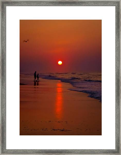 Meeting The Waves Framed Print by Ron Plasencia