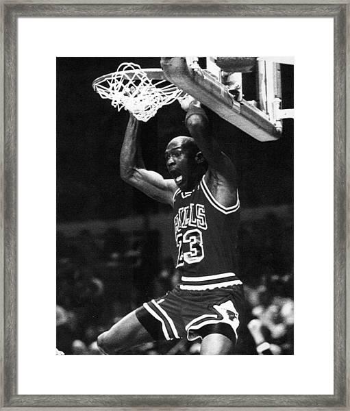 Michael Jordan Dunks Framed Print