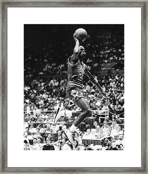Michael Jordan Gliding Framed Print