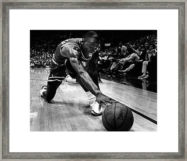 Michael Jordan Reaches For The Ball Framed Print by Retro Images Archive