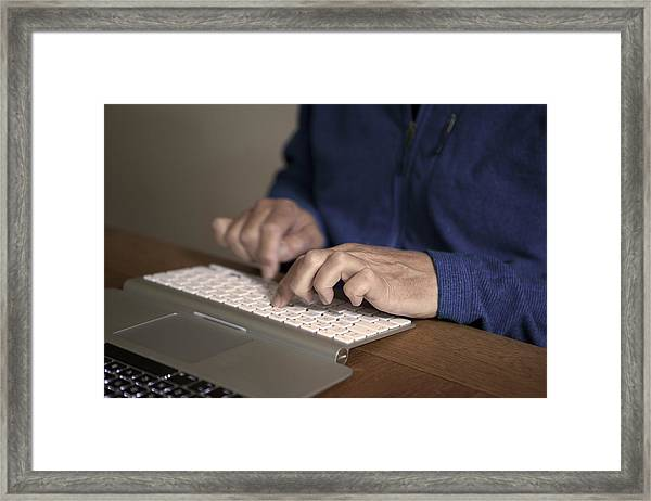 Midsection Of Man Typing On Keyboard At Table Framed Print by Paulien Tabak / EyeEm