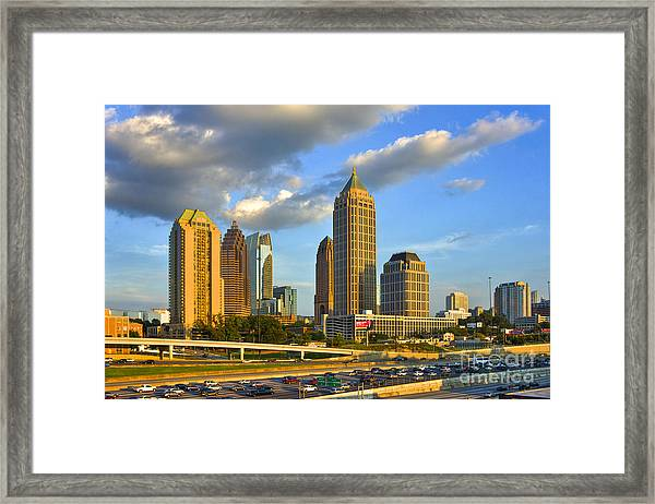 Midtown Sunset And Falcon Traffic  Framed Print
