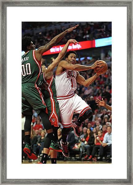 Milwaukee Bucks V Chicago Bulls - Game Framed Print by Jonathan Daniel