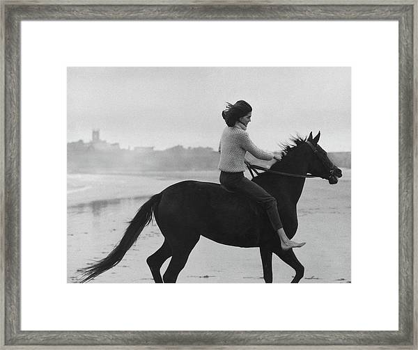 Minnie Cushing Riding A Horse Framed Print by Toni Frissell