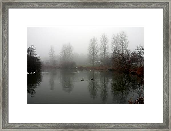 Misty Lake Reflections Framed Print