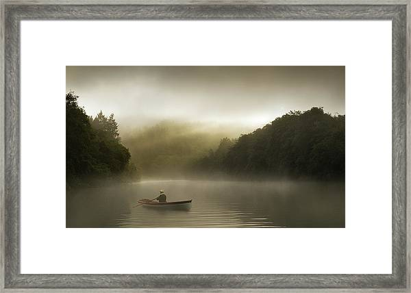 Misty Morning Row On A Forested River Framed Print by Justin Lewis