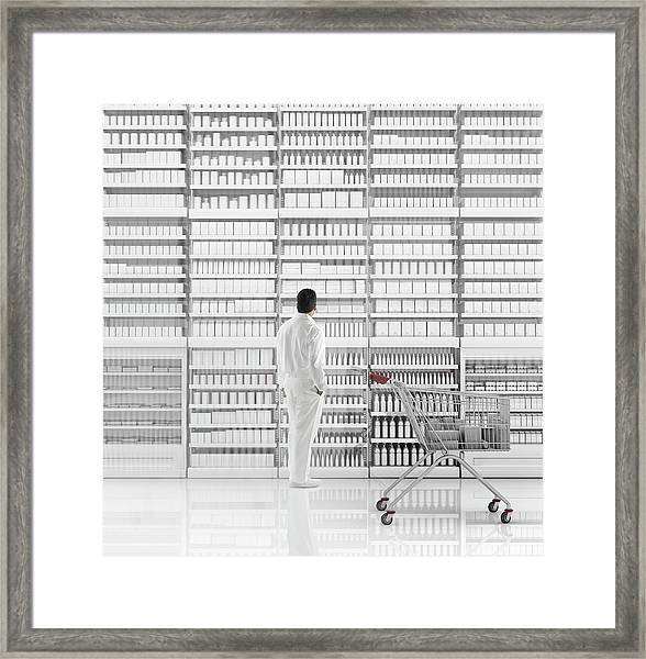 Mixed Race Man Shopping On White Framed Print by Colin Anderson Productions Pty Ltd