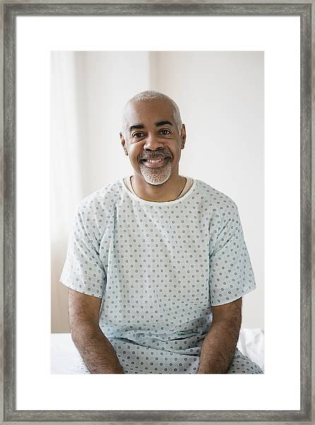 Mixed Race Older Man Sitting On Hospital Bed Framed Print by JGI/Jamie Grill