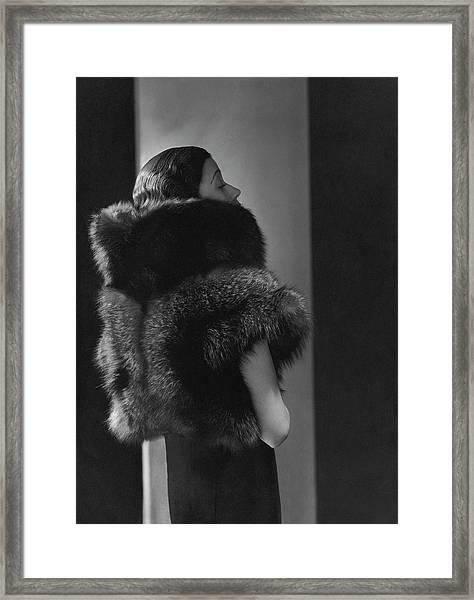 Mlle. Koopman Wearing A Fur Jacket Framed Print by George Hoyningen-Huene