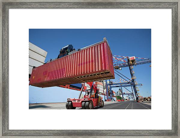 Mobile Crane Moving Cargo Container At Framed Print