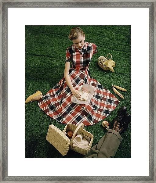 Model In Gingham Dress Sitting On A Staged Lawn Framed Print