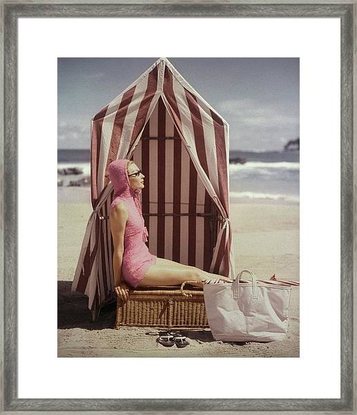 Model In Pink Swimsuit With Tent On Beach Framed Print