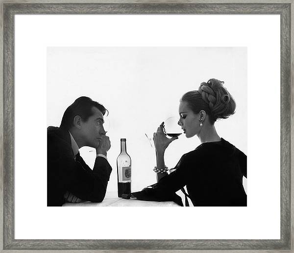 Man Gazing At Woman Sipping Wine Framed Print