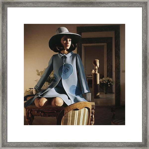 Model Sitting On A Desk Wearing A Double-faced Framed Print