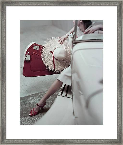 Model Stepping Out Of Car Framed Print