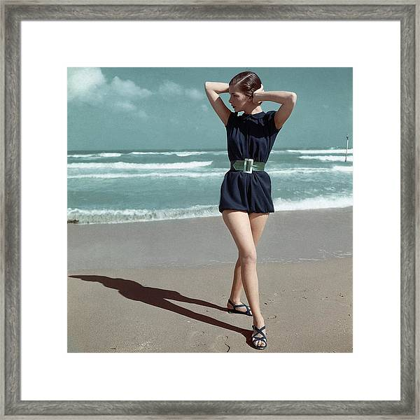 Model Wearing A Blue Swimsuit On A Beach Framed Print