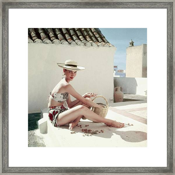Model Wearing A Calypso Patterned Bikini Framed Print by Henry Clarke