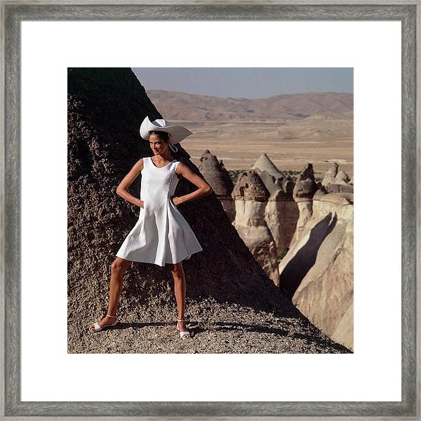 Model Wearing A White Dress By Chester Weinberg Framed Print