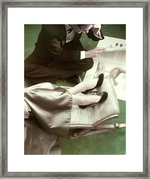 Model Wearing Velvet Pumps With A Man Sitting Framed Print