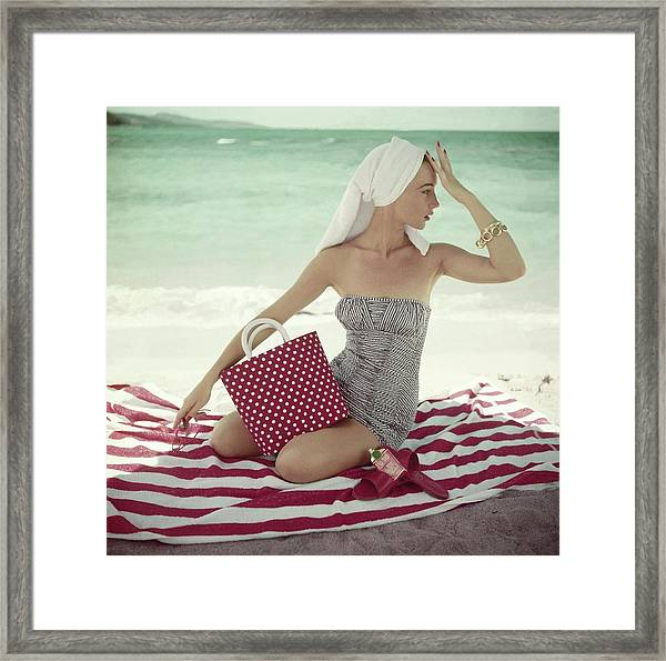 Model With A Polka Dot Bag On A Beach Framed Print