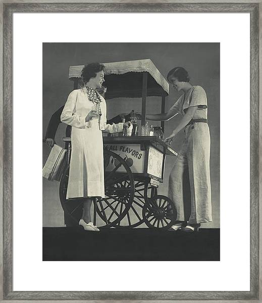 Models Beside A Hot Dog Wagon Framed Print