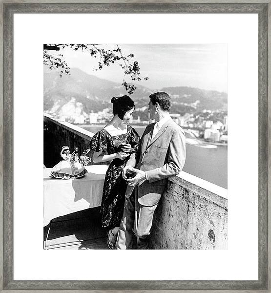 Models Holding Wine On A Balcony Framed Print