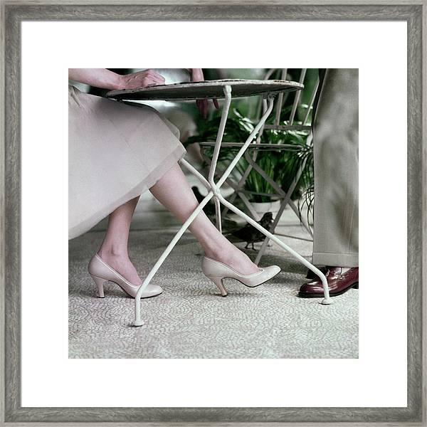 Model's Legs And Feet Wearing Pumps Framed Print