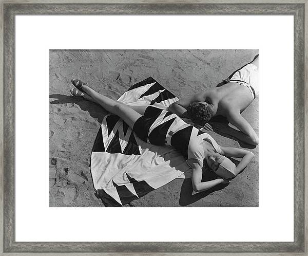 Models Lying On A Beach Framed Print