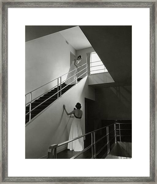 Models On A Staircase Framed Print