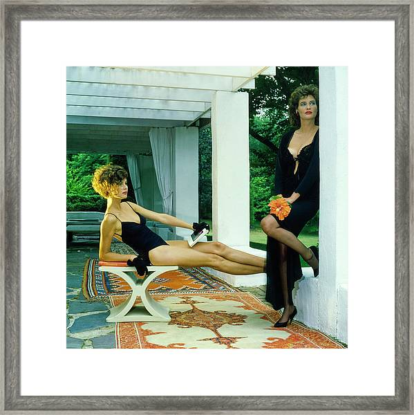 Models Wearing A Swimsuit And Lingerie On A Patio Framed Print