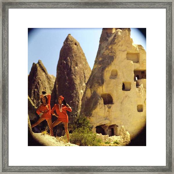Models Wearing Red Dresses By Caves Framed Print