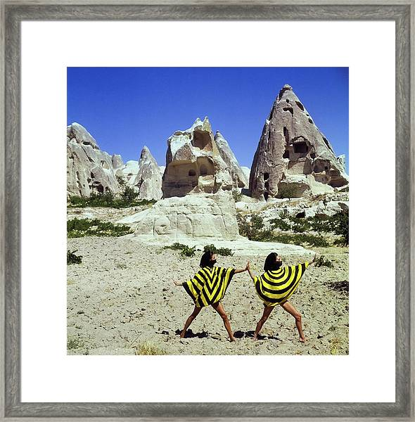 Models Wearing Striped Dresses By Caves Framed Print