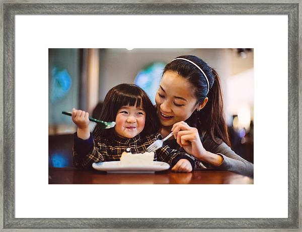 Mom & Toddler Girl Having Cake Joyfully In Cafe Framed Print by images by Tang Ming Tung