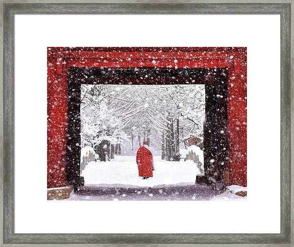Monk In Snowy Day Framed Print