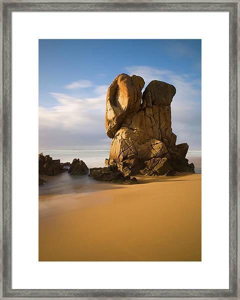 Monolithic Rock On The Beach Framed Print
