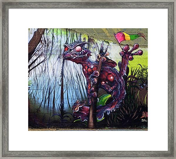 Monster With Flag Framed Print