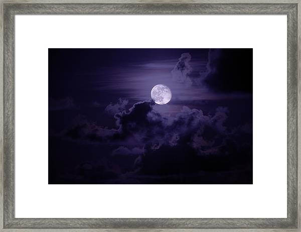 Moody Moon Framed Print