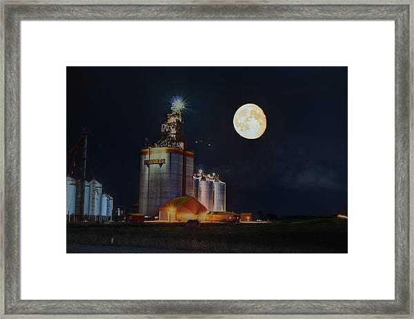Moon Glow Over Elevator Framed Print