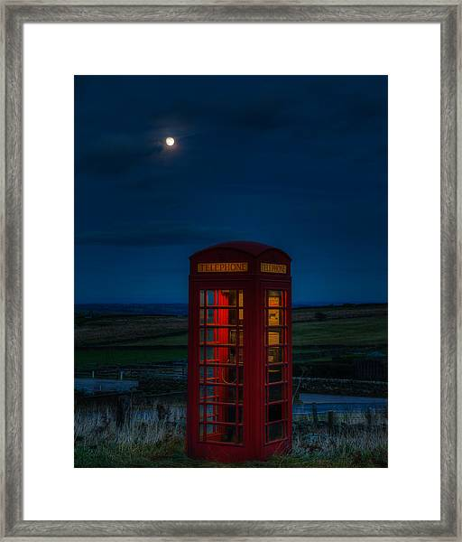 Moon Over Telephone Booth Framed Print