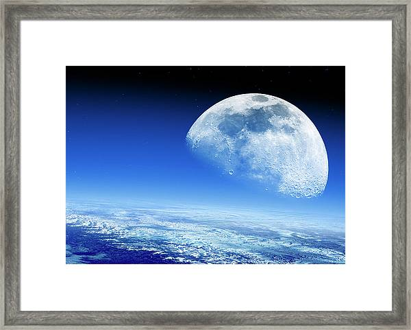Moon Rising Over Earth's Horizon Framed Print by Detlev Van Ravenswaay