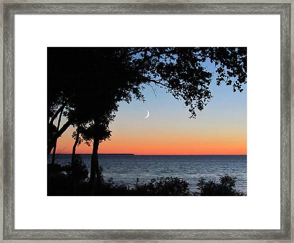Moon Sliver At Sunset Framed Print