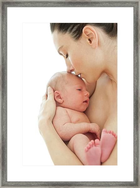 Mother Holding Newborn Baby Boy Framed Print by Ian Hooton