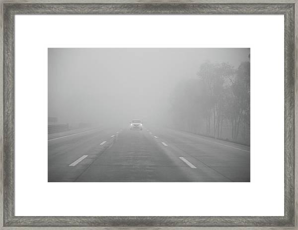 Motorway Driving In Fog Framed Print