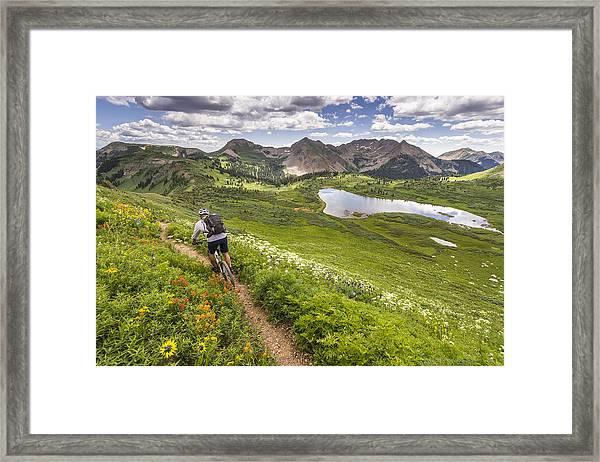 Mountain Biker On Green Trail Framed Print by Image Source RF/©Whit Richardson