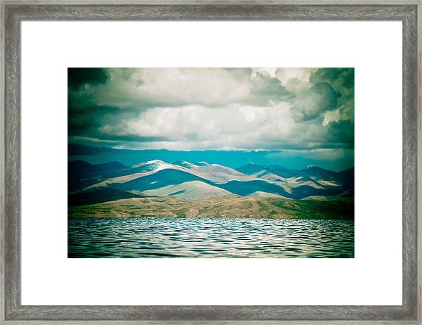 Framed Print featuring the photograph Mountain Lake In Tibet Manasarovar by Raimond Klavins