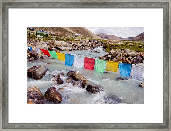 Framed Print featuring the photograph Mountain River And Buddhist Flags Lungta  by Raimond Klavins