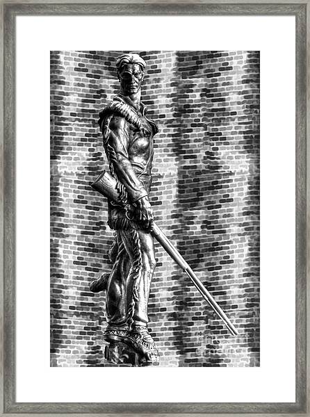 Mountaineer Statue With Black And White Brick Background Framed Print