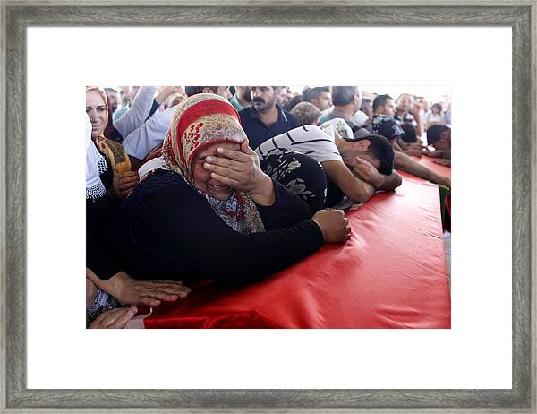 Mourners Attend The Funerals Of Those Killed In The Turkish Bomb Blast Framed Print by Gokhan Sahin