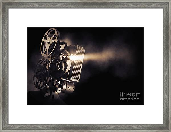 Movie Projector On A Dark Background Framed Print