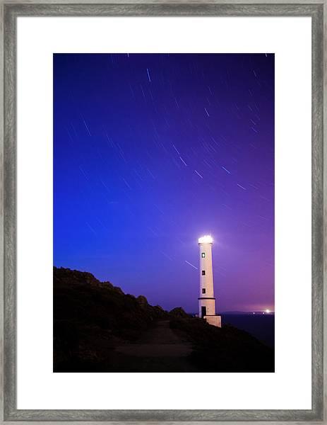 Moving Stars Around Lighthouse Framed Print